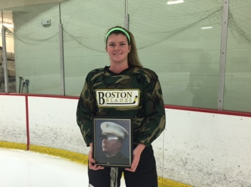 Grace Murphy holds a photo of her dad.
